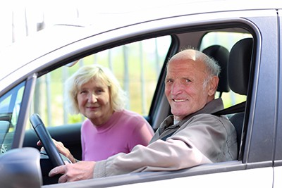 Happy senior couple driving   When should you retire from driving
