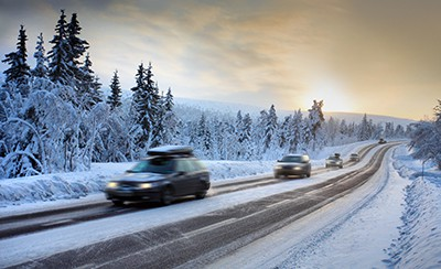 Motion Blur of Car Driving Down Snow Covered Road | Preventing Car Accidents during the Snowy Holidays