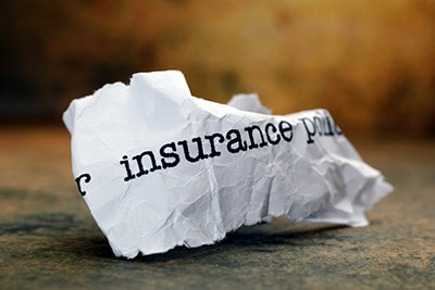 crumpled paper with words insurance policy on it | File A Claim On An Insurance Policy