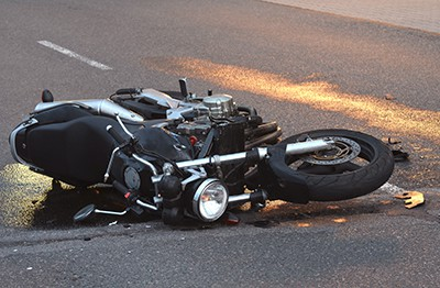 black motorcycle on it's side in the road | Hit and Run Motorcycle Accident in Colorado