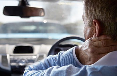 Driver Suffering From Whiplash After Traffic Collision | Minor Impacts Can Lead to Major Injuries