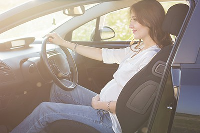 Pregnant woman in driving seat of the car | Northglenn Car Accident Attorneys for Pregnant Women