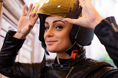 Cute young woman wearing a motorcycle helmet   Car Accident Related Facial Lacerations