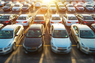 full parking lot and sundown | Parking Lot Slip and Fall Accidents