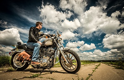 Biker in sunglasses and leather jacket on the road | Catastrophic Motorcycle Accidents