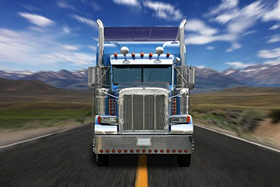 truck speeding down highway coming towards viewer | Trucking Accident Questions