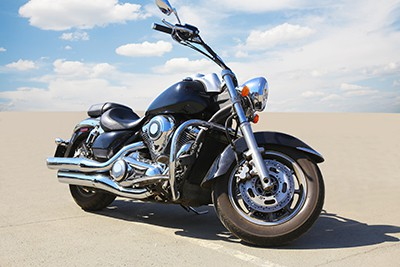 big powerful motorcycle on asphalt against sky | Thornton Motorcycle Accident Lawyers