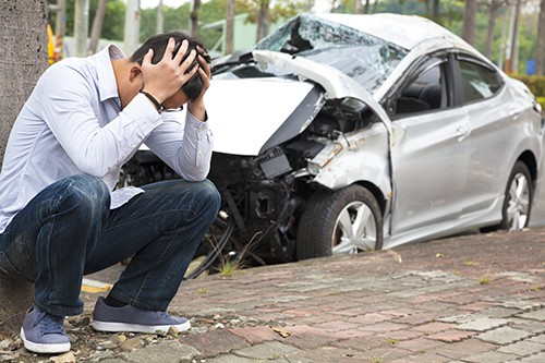 man upset and holding his head after a car accident | Broomfield car accident lawyers