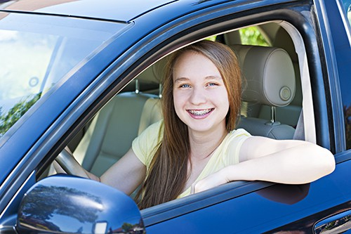 smiling teen girl driver | Keeping Teens Safe While Driving