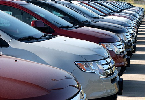 Line of car hoods in a dealership | Accident Prone Cars