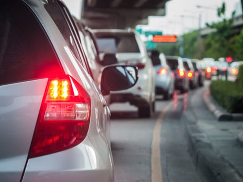 long line of car taillights on a city street | Top 10 Causes of Car Accidents