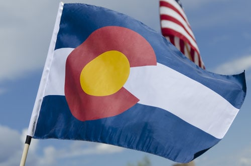 Colorado and american flags blowing in the wind | How Healthy are Coloradans?