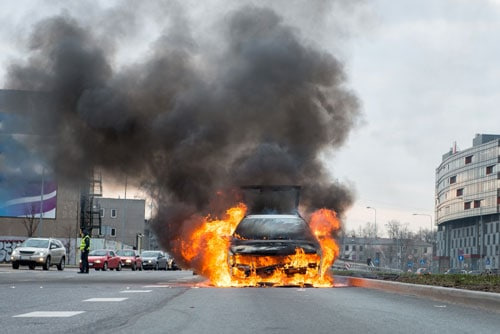 car on fire in the street | Burn Injuries after a Car Accident | Broomfield Burn Injury Attorneys