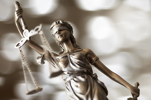 a statue of lady justice | things to consider before hiring a personal injury attorney