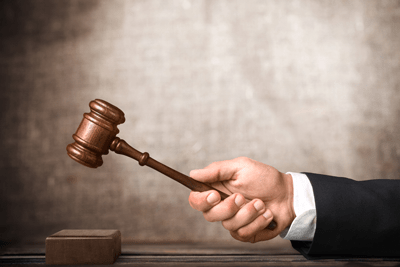 judges hand swinging wooden gavel | Thornton Insurance Dispute Lawyers