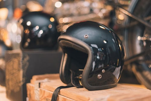 classic motorcycle helmet on display in store | Guide to Motorcycle Safety in Colorado