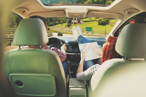 couple on road trip in the summer | Dangers of Summer Driving