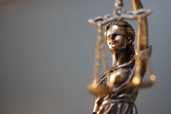 lady justice statue close up | Understanding Contingency Fees