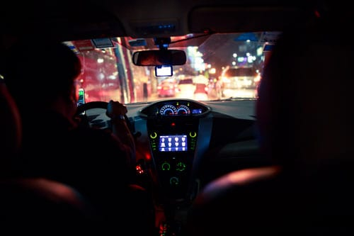 view through the windshield of a cab at night from backseat | After a Ridesharing Accident