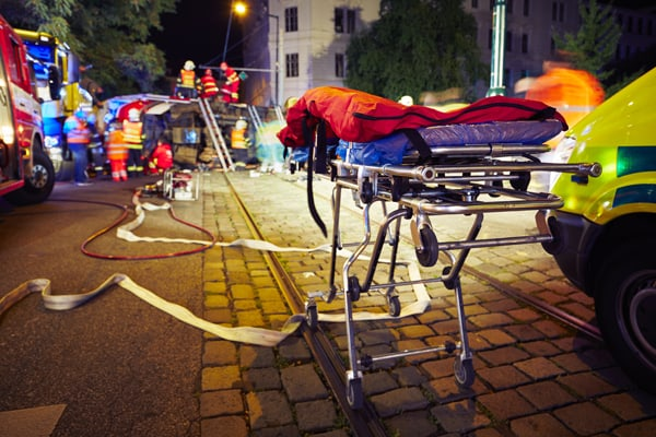 gurney and emergency vehicles at an accident scene | Fatal Accidents and the Youth