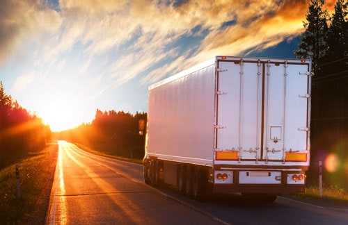 semi truck driving at sunset | Increase in Trucking Accident Fatalities