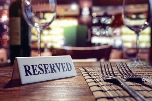reserved sign on set table in restaurant | Restaurant Liability Accidents