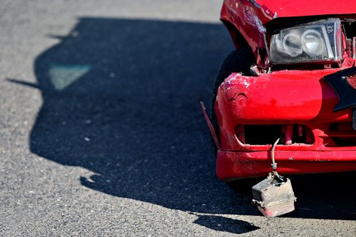 front of red car | Hit and Run Accidents are On the Rise
