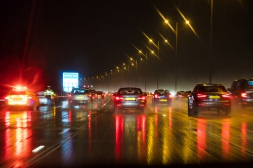 cars driving on a highway, raining | colorado the worst state for driving