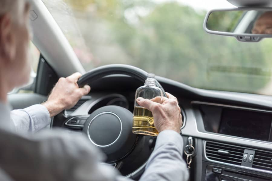driver drinking alcohol while driving | Repeat Drunk Drivers