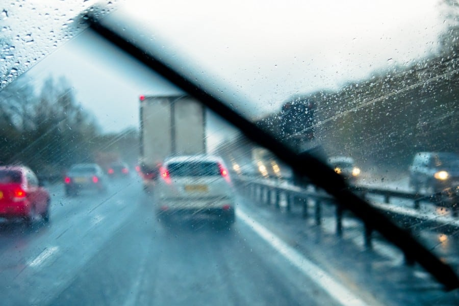 driving on the highway while raining | Light Rain Increases Risk of Traffic Fatalities