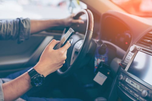 man texting while driving | Eva Marie Goddard Brown in Fatal Distracted Driving Accident