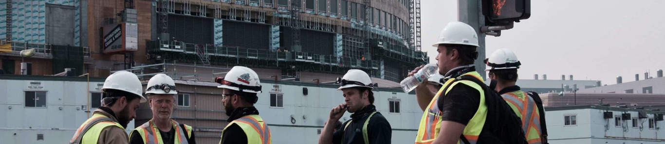 Construction Workers discussing the Workers Compensation Act
